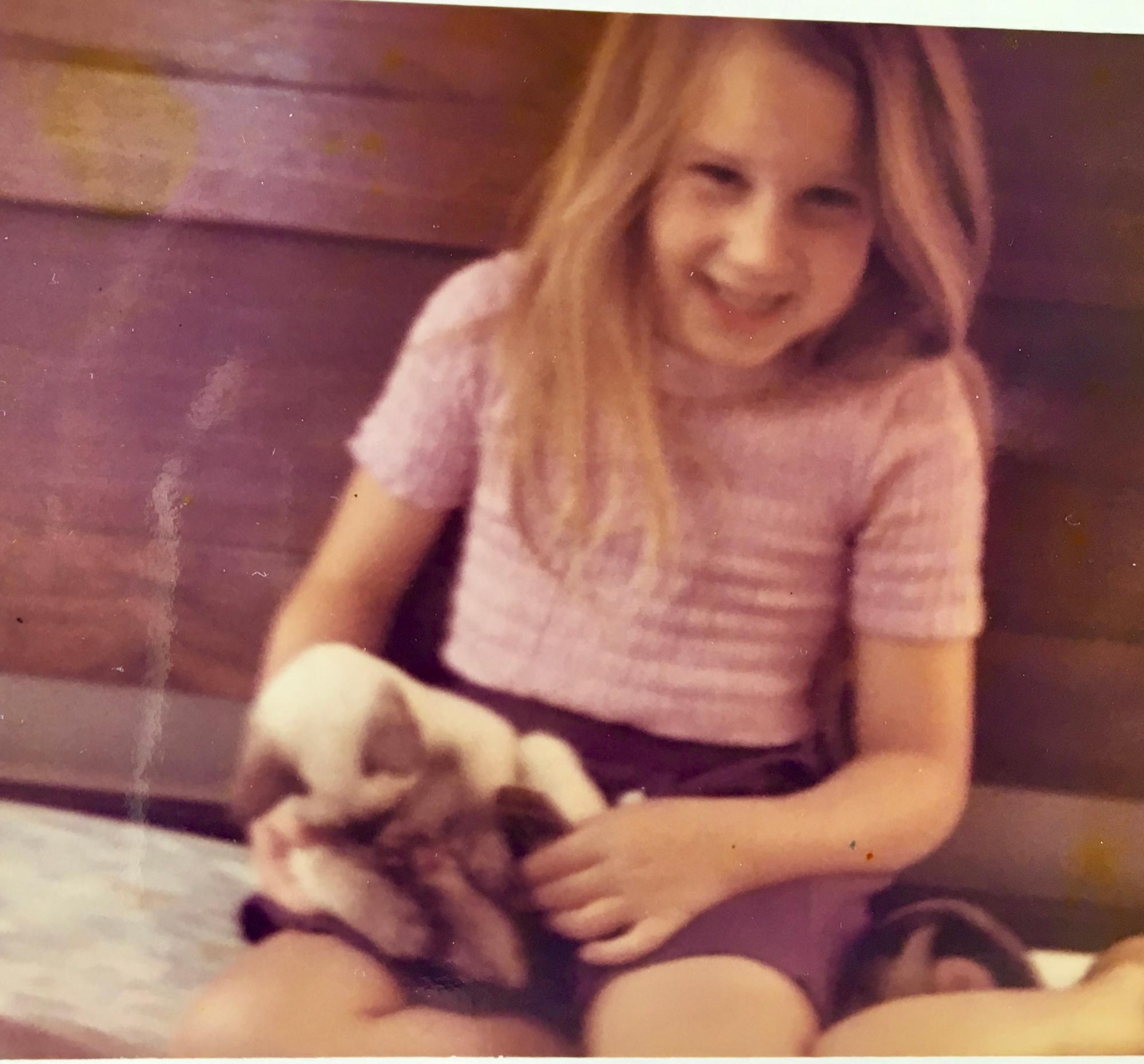 photo of J. Wilder Bill when a child with her kitten