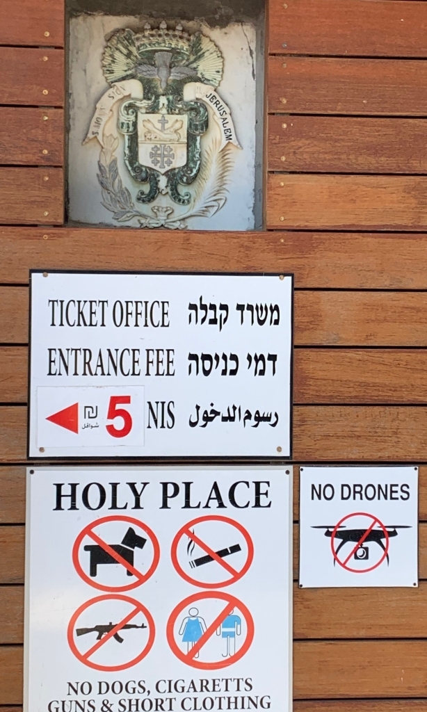 Sign in Capernaum, Israel by J. Wilder Bill